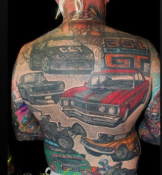 colorful-car-back-tattoo-on-muscular-man